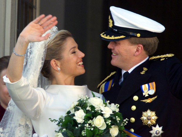 Dutch Crown Prince Willem-Alexander and his wife Princess Maxima smile to each other as they wave to..